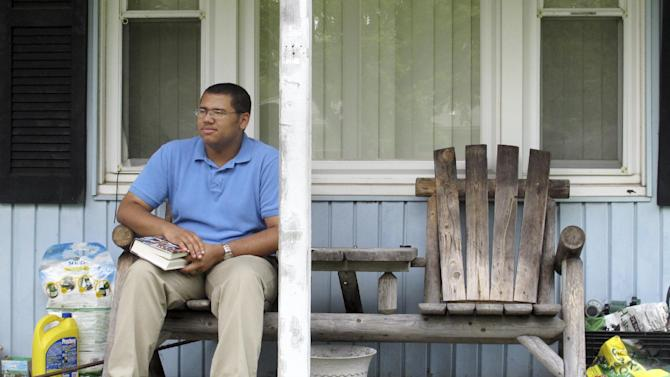 David Vernon, 18, takes a break while reading on his porch in Columbus, Ohio