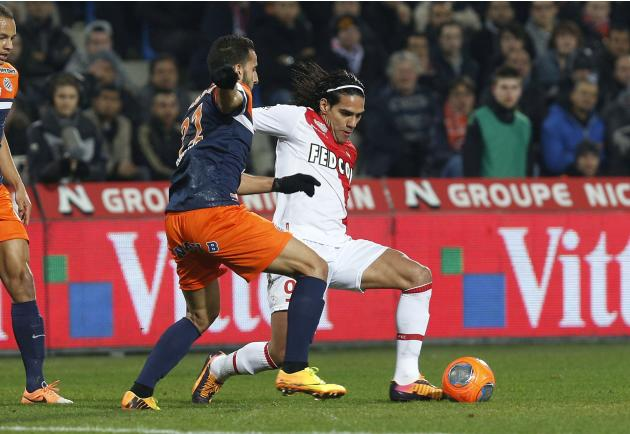 Montpellier's El Kaoutari challenges Falcao of Monaco during their French League soccer match at the Mosson Stadium in Montpellier