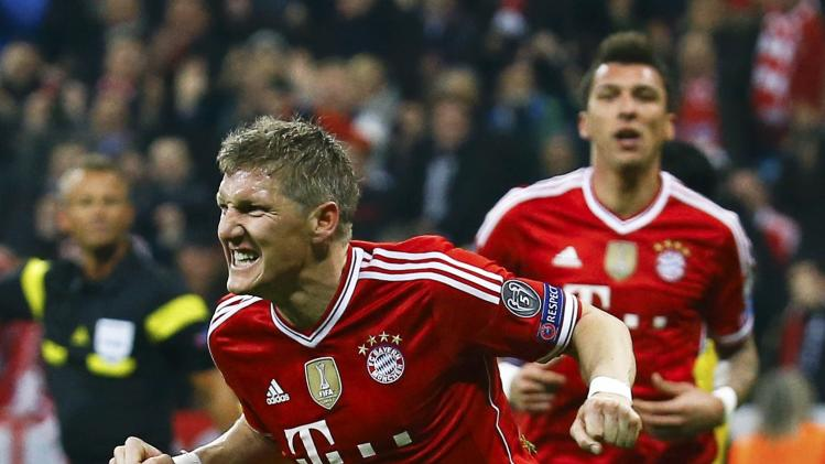 Bayern Munich's Schweinsteiger celebrates next to Mandzukic after scoring a goal against Arsenal during their Champions League round of 16 second leg soccer match in Munich