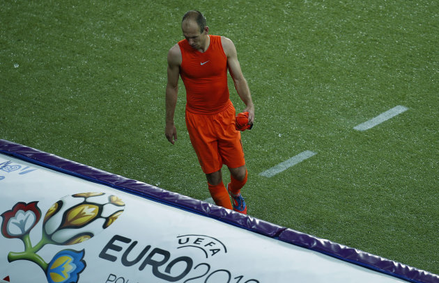 Arjen Robben of the Netherlands leaves the pitch after being substituted during the Euro 2012 soccer championship Group B match between the Netherlands and Germany in Kharkiv, Ukraine, Wednesday, June 13, 2012. (AP Photo/Vadim Ghirda)