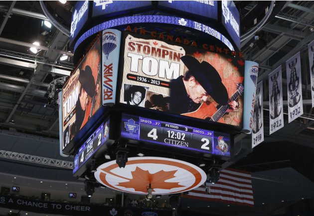 A tribute is shown on the scoreboard to the late country singer Stompin' Tom Connors during the NHL hockey game between the Toronto Maple Leafs and Ottawa Senators in Toronto