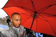 Lewis Hamilton, pictured on July 6, dropped a heavy hint on Thursday that he is ready to re-sign with McLaren and stay with the team that has been his second home nearly all his motor racing career