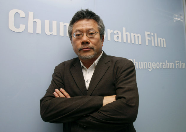 In this July 17, 2012 photo, Choi Yong-bae, Chungeoraham Film CEO and Producer, poses during an interview with the Associated Press at his office in Seoul, South Korea. After being turned down by many investors over the last four years, Choi said it feels strange and exciting that his revenge film about a notorious South Korean president blamed for the massacre of democracy protesters is finally coming to life through online donations. (AP Photo/Ahn Young-joon)