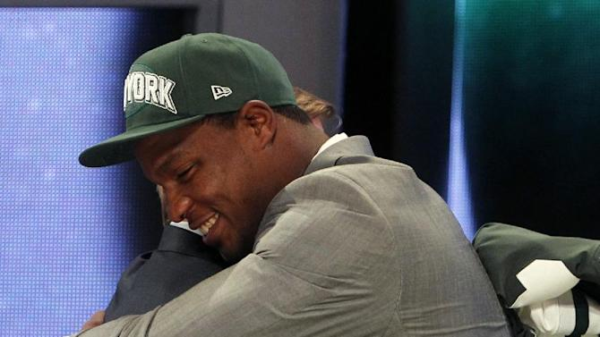 FILE - In this April 26, 2012,  file photo, North Carolina defensive end Quinton Coples, right, hugs NFL Commissioner Roger Goodell after being selected as the 16th pick overall by the New York Jets in the first round of the NFL football draft in New York. How many hugs can Roger Goodell endure from all the burly offensive and defensive players expected to be selected in the first round? Last year, he embraced many first-round picks who took the stage and was nearly hugged into submission_one of the things to watch for during the three-day NFL draft beginning Thursday, April 25, 2013. (AP Photo/Jason DeCrow, File)