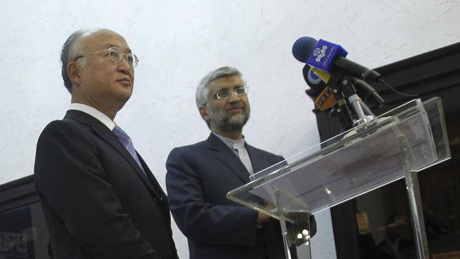 Iran's top nuclear negotiator, Saeed Jalili, right, and International Atomic Energy Agency (IAEA) chief Yukiya Amano, attend a news briefing at the conclusion of their meeting, in Tehran, Iran, Monday, 21, 2012. The head of the U.N. nuclear agency arrived Monday in Tehran on a key mission that could lead to the resumption of probes by the watchdog on whether Iran has secretly worked on an atomic weapon. It would also strength the Islamic Republic's negotiating hand in crucial nuclear talks with six world powers later this week in Baghdad. (AP Photo/IRNA,Adel Pazzyar)