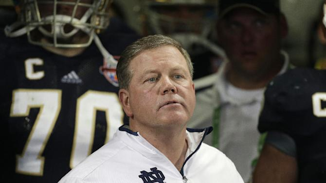 FILE - Notre Dame head coach Brian Kelly watches play against Alabama during the second half of the BCS National Championship college football game in this Jan. 7, 2013 file photo taken in Miami. The Philadelphia Eagles interviewed Notre Dame coach Brian Kelly Tuesday Jan 8, 2013 for their coaching vacancy, a person familiar with the meeting told The Associated Press.  (AP Photo/Chris O'Meara)