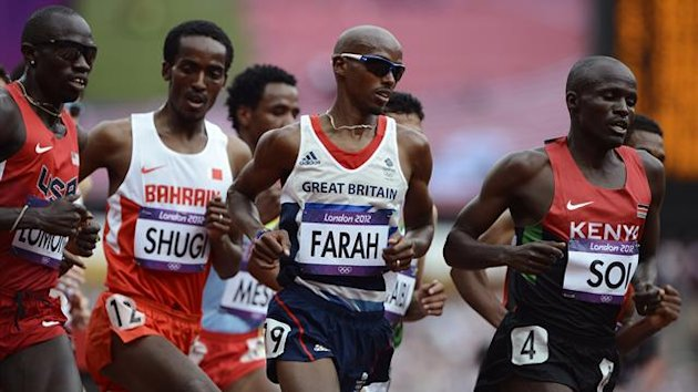 Britain's Mo Farah (C) competes in his men's 5000m round 1 heat during the London 2012 Olympic Games at the Olympic Stadium