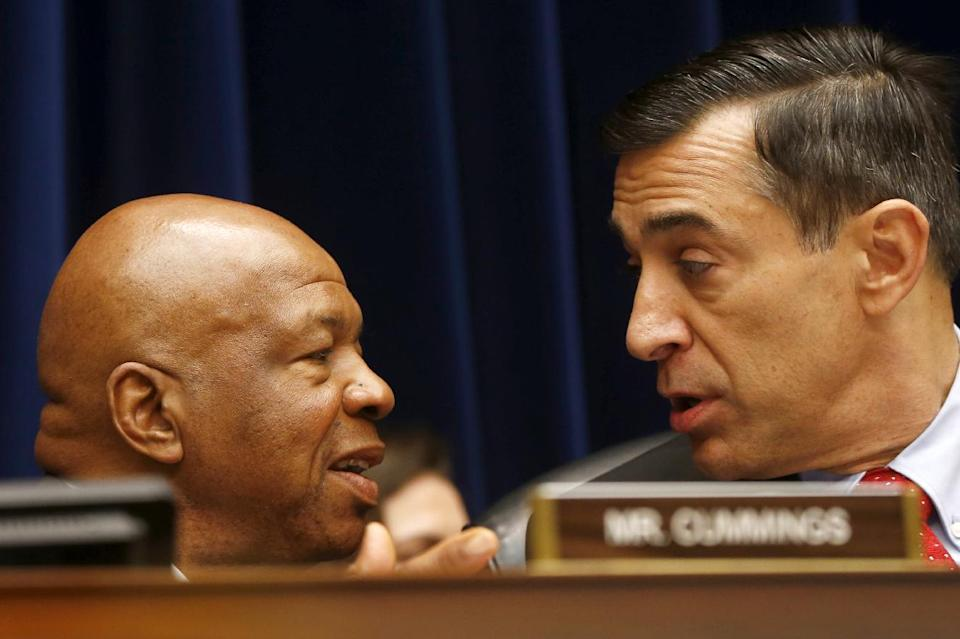 House Oversight and Government Reform Committee Chairman Rep. Darrell Issa, R-Calif., right, talks with the committee's ranking Democrat Rep. Elijah Cummings, D-Md. on Capitol Hill in Washington, Thursday, June 6, 2013, during the committee's hearing regarding IRS conference spending. (AP Photo/Charles Dharapak)