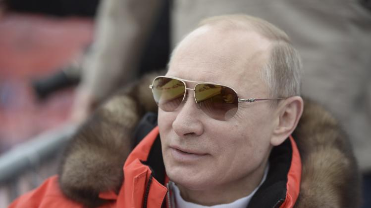 Russian President Vladimir Putin watches a skiing event at the Paralympic Winter Games at Rosa Khutor near Sochi