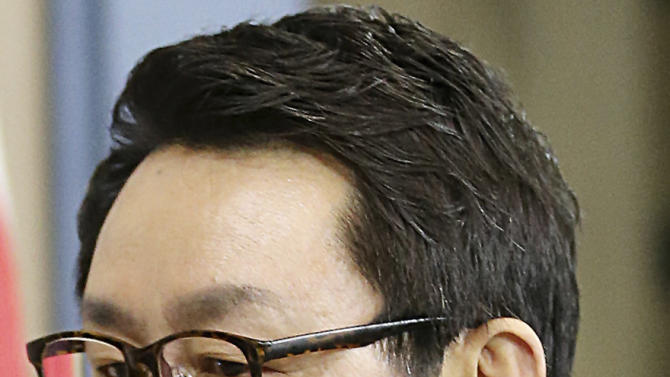 """In this undated photo released by Yonhap News Agency, South Korean President's spokesman Yoon Chang-jung is seen at the presidential Blue House in Seoul, South Korea. President Park Geun-hye's office says she has fired her chief spokesman after a """"disgraceful incident"""" during Park's trip to the United States. Media reports say the spokesman was accused of sexual abuse.(AP Photo/Yonhap) KOREA OUT"""
