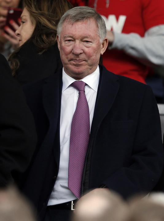 Former Manchester United manager Ferguson takes his seat in the stands before their English Premier League soccer match against Liverpool in Manchester