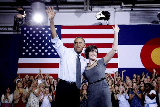 President Barack Obama, accompanied by Sandra Fluke, waves at a campaign in Denver, Wednesday, Aug. 8, 2012. Fluke is a Georgetown law student who inadvertently gained notoriety when talk show host Ru