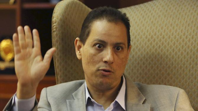 Mohamed Omran, chairman of the Egyptian Exchange, talks during an interview with Reuters at his office in Cairo