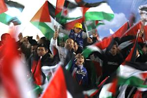 Palestinians celebrate in the West Bank city of Ramallah…