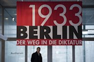 "A banner advertises the exhibition ""Berlin 1933"" at the Topography of Terror museum in Berlin. Chancellor Angela Merkel has said Adolf Hitler's rise to power 80 years ago should go on reminding Germans that democracy and freedom cannot be taken for granted"