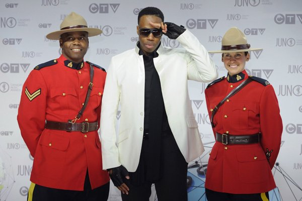 Rapper Kardinal Offishal looks dashing in a shockingly white jacket and contrasting black shirt, pants and fingerless gloves. He tops it off with some sweet sunnies. THE CANADIAN PRESS/Sean Kilpatrick