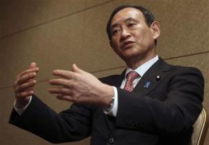 Japan's Chief Cabinet Secretary Suga speaks during an interview with Reuters in Tokyo