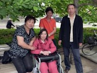 China&#39;s disabled rights activist Ni Yulan (centre) and her husband Dong Jiqin (orange shirt) pose with friends at Beijing&#39;s Imperial City Heritage Park in 2010. Ni Yulan has been beaten, barred from practising law, and repeatedly jailed for fighting the forced evictions of thousands to make way for Beijing&#39;s Olympic makeover