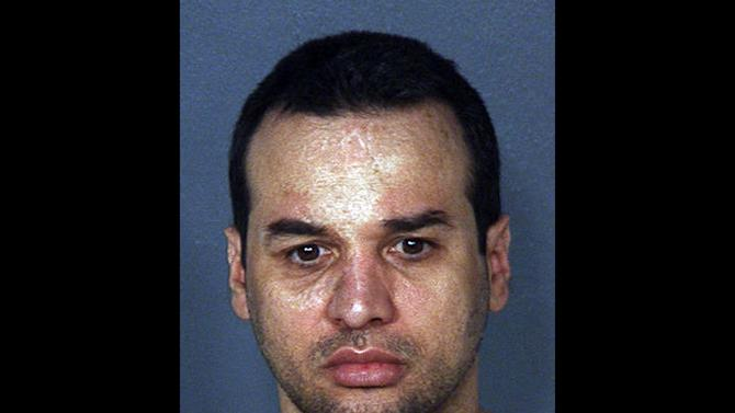 This 2007 image provided by the Las Vegas Metropolitan Police Department shows Alberto Morales. Morales, 42, stabbed one of two police escorts and escaped Monday in the Dallas area as he was being transferred from Florida to Nevada, police said Tuesday Feb. 12, 2013. (AP Photo/LVMPD)