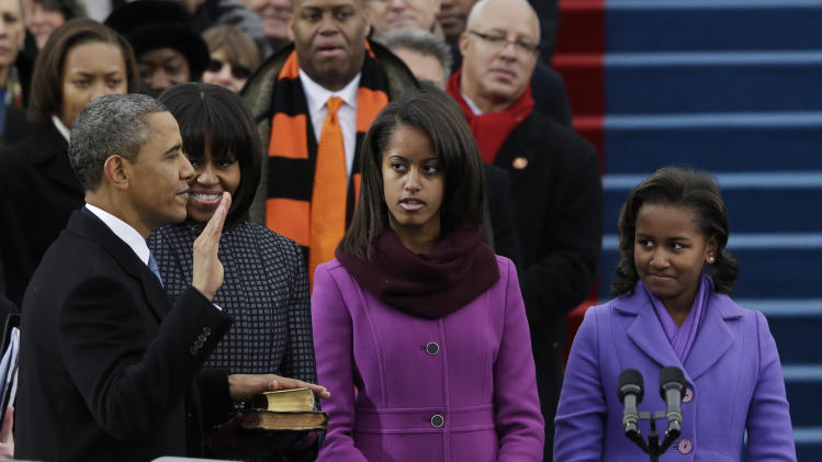 President Barack Obama's family watches during the ceremonial swearing-in at the U.S. Capitol during the 57th Presidential Inauguration in Washington, Monday, Jan. 21, 2013. (AP Photo/Pablo Martinez Monsivais)