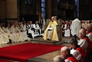 The new Archbishop of Canterbury Justin Welby sits in the Chair of St Augustine during his enthronement ceremony at Canterbury Cathedral, in Canterbury, southern England March 21, 2013. The new spiritual leader of the world's Anglicans was enthroned by a female cleric on Thursday, taking the helm at a time when the troubled church risks tearing itself apart over gay marriage and women bishops. REUTERS/Gareth Fuller/Pool