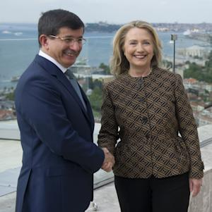 Turkish Foreign Minister Ahmet Davutoglu, left, shakes hands with U.S. Secretary of State Hillary Rodham Clinton before a meeting in Istanbul Thursday, June 7, 2012. (AP Photo/Saul Loeb, Pool)