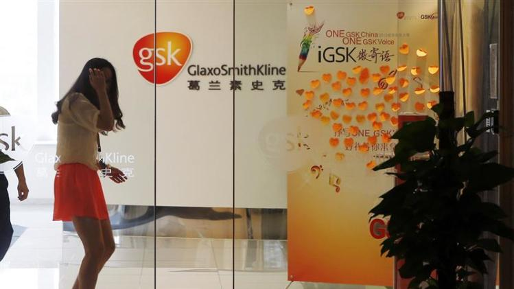 File picture shows an employee walking inside a GlaxoSmithKline office in Shanghai