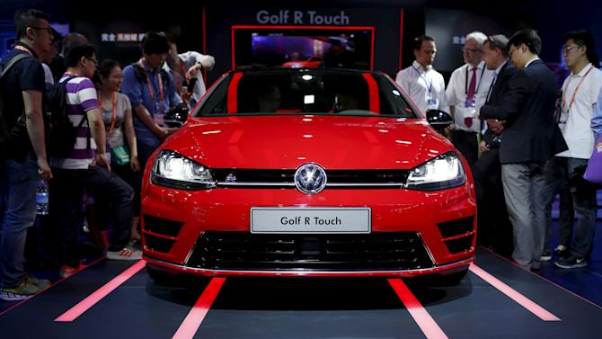 File picture of attendees looking at a Volkswagen Golf R Touch car during the 2015 International Consumer Electronics Show Asia in Shanghai