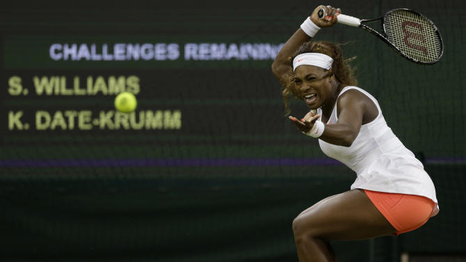 Serena Williams of the United States plays a return to Kimiko Date-Krumm of Japan during their Women's singles match at the All England Lawn Tennis Championships in Wimbledon, London, Saturday, June 29, 2013. (AP Photo/Anja Niedringhaus)