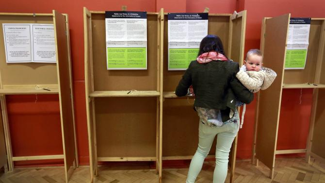 A mother votes in central Dublin as Ireland holds a referendum on gay marriage