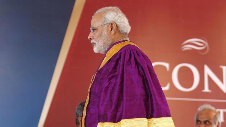 Gujarat's chief minister and Hindu nationalist Narendra Modi walks during a convocation ceremony at PDPU at Gandhinagar