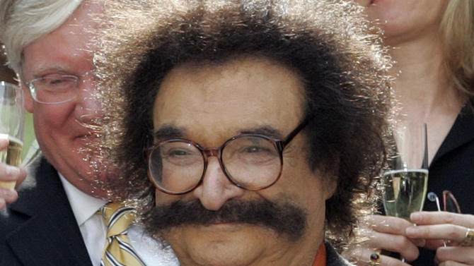 "FILE - In this May 31, 2006 file photo, film critic Gene Shalit is seen during a toast with ""Today"" show cast and crew at the end of Katie Couric's final show, in New York.  Shalit, 86, faces a charge of driving to endanger after his vehicle struck a utility pole and came to rest against a home in Lenox, Mass., Wednesday, Oct. 24, 2012, according to police.  (AP Photo/Richard Drew, File)"