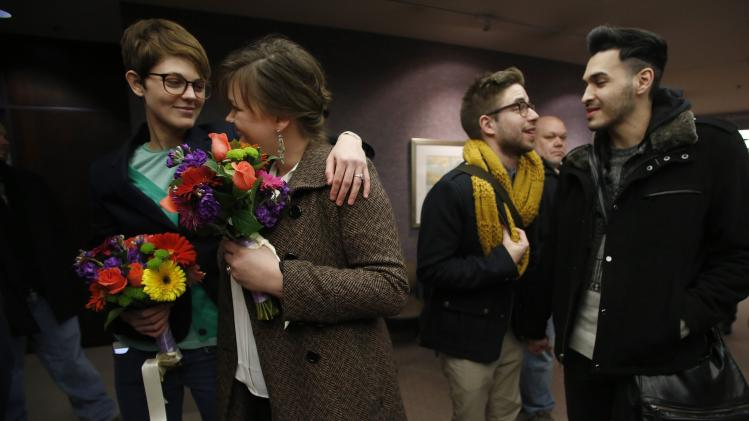 Natalie Dicou, Nicole Christensen, James Goodman and Jeffrey Gomez, wait to get married at the Salt Lake County Clerks office in Salt Lake City, Utah