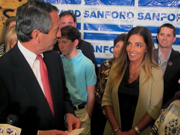 Former South Carolina Gov. Mark Sanford thanks his fiance Maria Belen Chapur as he addresses supporters in Mount Pleasant, S.C., on Tuesday, April 2, 2013, after winning the GOP nomination for the U.S