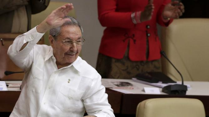 Cuba's President Raul Castro waves to the crowd after a speech during the National Assembly in Havana