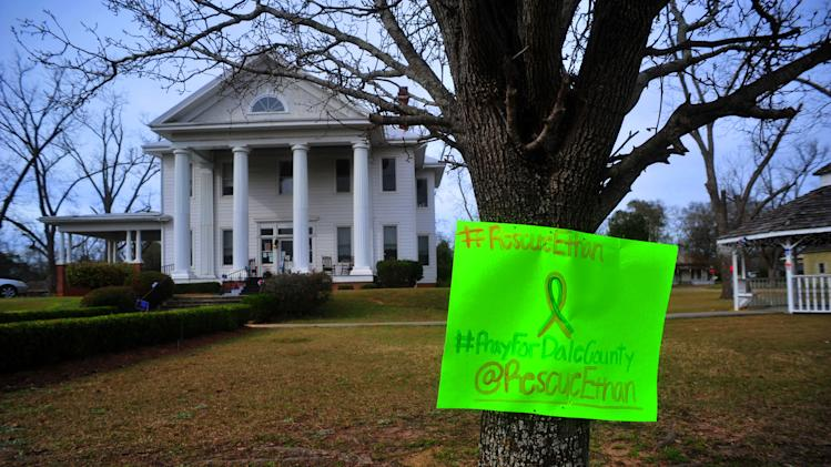 A sign posted on a tree in front of the Midland City Town Hall on Monday, Feb. 4, 2013 asks for prayers and a safe rescue for a boy named Ethan who was taken hostage last week. Authorities stormed an underground bunker Monday in Alabama, freeing the 5-year-old boy who had been held hostage in the tiny underground shelter and leaving the boy's abductor dead. (AP Photo/The Dothan Eagle, Jay Hare)