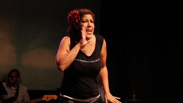 "This publicity photo released by David Gersten & Associates shows actress, Rain Pryor, in her solo show ""Fried Chicken and Latkes,"" currently performing off-Broadway at Actors Temple Theatre in New York.  AP Photo/David Gersten & Associates, Peter Zimmern."