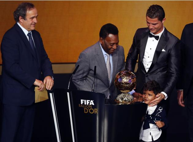 Portugal's Cristiano Ronaldo looks at his son Cristiano Ronaldo Jr with Pele as UEFA President Michel Platini looks on after Ronaldo was awarded the FIFA Ballon d'Or 2013 in Zurich