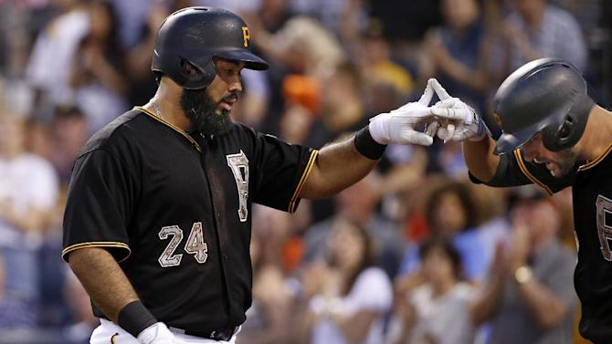 Pittsburgh Pirates' Pedro Alvarez (24) celebrates with teammate Jordy Mercer on his way to the dugout after hitting a solo-home run off Miami Marlins starting pitcher David Phelps in the sixth inning of a baseball game in Pittsburgh, Monday, May 25, 2015. The Pirates won 4-2. (AP Photo/Gene J. Puskar)