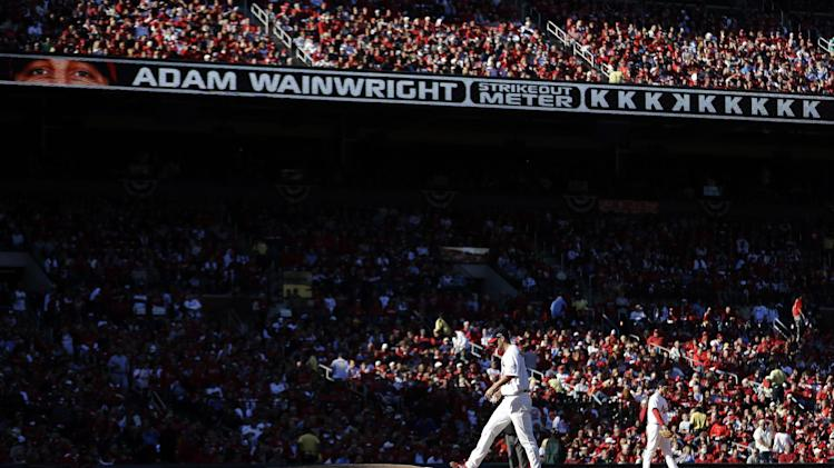 St. Louis Cardinals starting pitcher Adam Wainwright walks back to the mound after striking out Washington Nationals' Ryan Zimmerman during the fifth inning in Game 1 of baseball's National League division series, Sunday, Oct. 7, 2012, in St. Louis. (AP Photo/Jeff Roberson)
