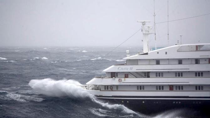 """This Dec. 7, 2010 photo shows the Antarctic tourist ship the """"Clelia II"""" struggling in high seas with 165 people aboard in the southern Drake Passage, just north of the Shetland Islands. The ship declared an emergency on Tuesday, reporting it had suffered engine damage amid heavy seas and 55 mph (90 kph) winds when it was about 500 miles (845 kilometers) from Ushuaia, the Argentine Navy said in a statement. (AP Photo/Fiona Stewart, Garett McIntosh)"""