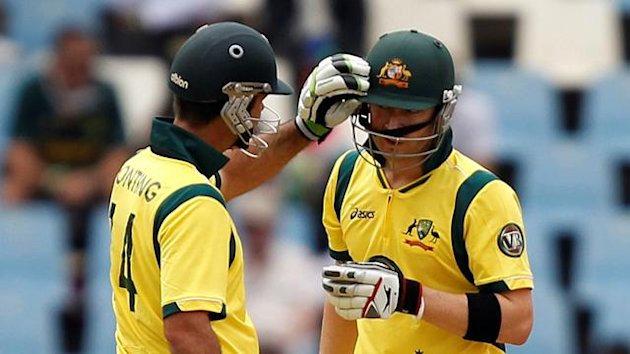 Ricky Ponting (L) of Australia attends to his captain Michael Clarke after he was hit by a ball during the first One Day International (ODI) cricket match against South Africa in Centurion