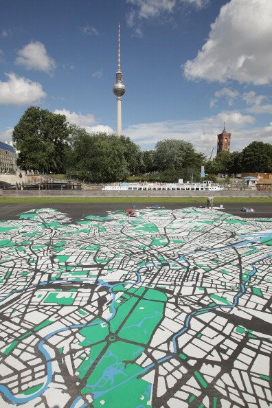 ast tower at Alexanderplatz and City Hall (R) on August 6, 2012 in Berlin, Germany. The map, which will measure 50 meters X 50 meters when finished, is in the scale of 1:775 and is an art installation