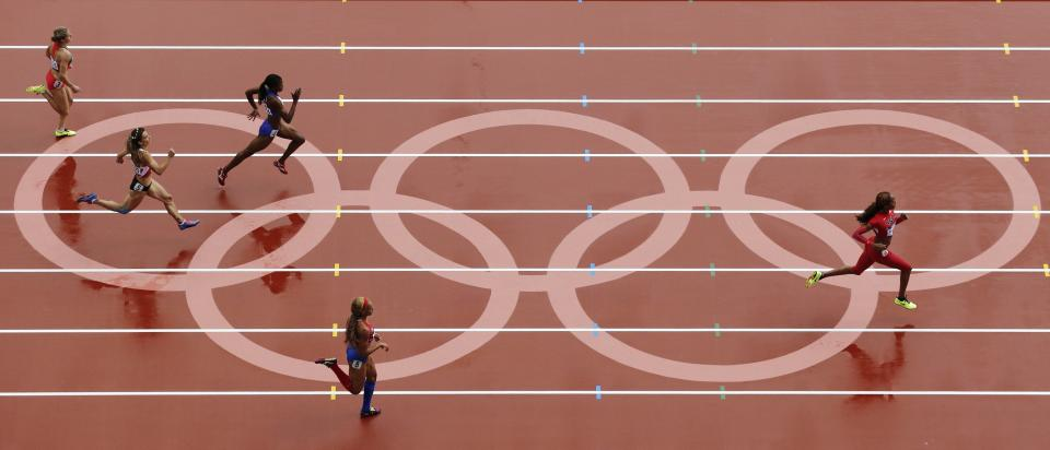 United States' Sanya Richards-Ross, right, runs in a women's 400-meter heat at the 2012 Summer Olympics, Friday, Aug. 3, 2012, in London. (AP Photo/Mark Duncan)