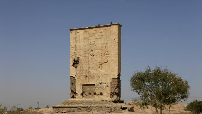 The image of former President Saddam Hussein still stands at the archaeological site of Babylon, about 50 miles (80 kilometers) miles south of Baghdad, Iraq. A decade on from the invasion that ousted the strongman, Iraqis still grapple with the country's postwar identity and how much should be done to wipe away the dictator's influence.(AP Photo/Karim Kadim)