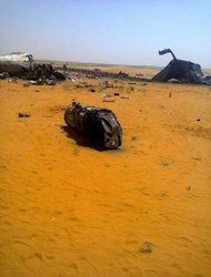 The wreckage of a plane that crashed in Sudan is pictured in this photo taken via mobile phone. Fifteen Sudanese military personnel were killed and seven others injured when their transport plane crashed west of Khartoum on Sunday on its way to conflict-plagued Darfur, state media reported