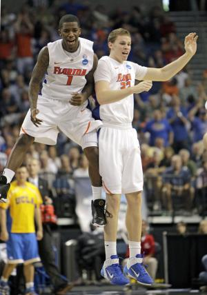 Florida's Kenny Boynton (1) celebrates with teammate Erik Murphy, after Murphy made a 3-point shot during the second half of a Southeast Regional third-round NCAA tournament college basketball game against UCLA in Tampa, Fla., Saturday, March 19, 2011. Florida won 73-65.(AP Photo/John Raoux)