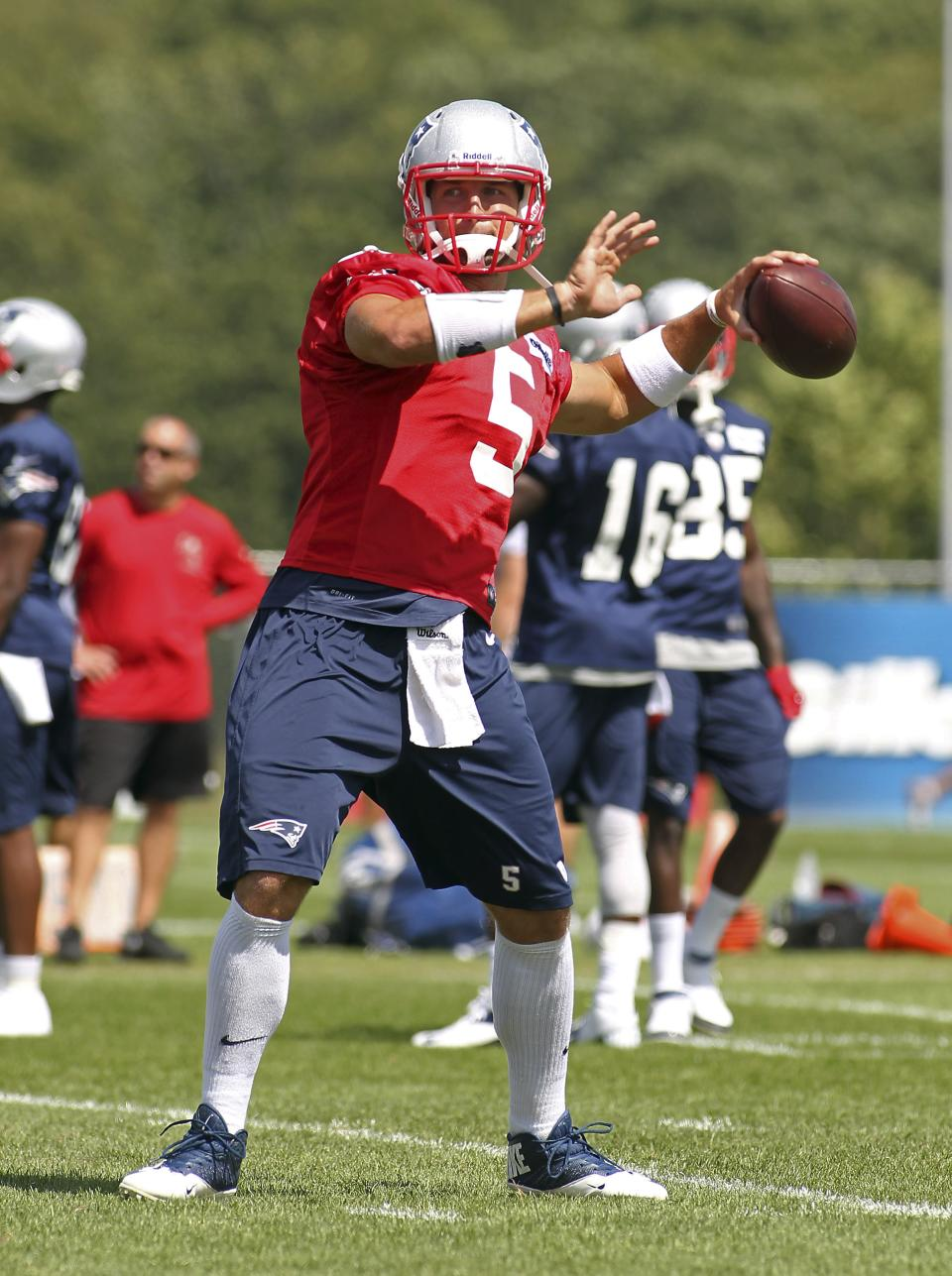 New England Patriots quarterback Tim Tebow throws a pass during the Patriots' joint workout with the Tampa Bay Buccaneers at NFL football training camp, in Foxborough, Mass., Thursday, Aug. 15, 2013. (AP Photo/Stew Milne)