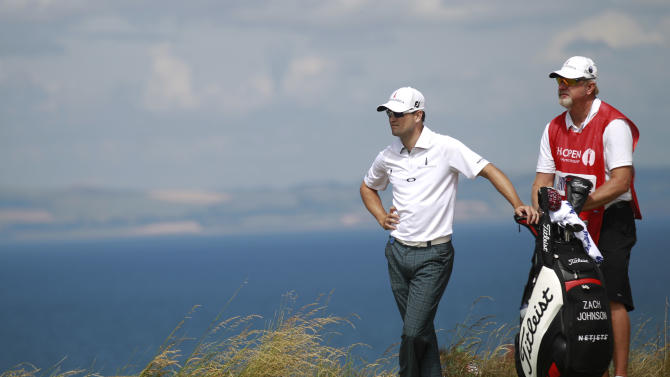 Zach Johnson of the United States prepares to play off the 12th tee during the first round of the British Open Golf Championship at Muirfield, Scotland, Thursday July 18, 2013. (AP Photo/Peter Morrison)