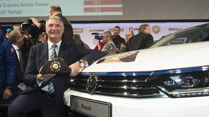 Heinz-Jakob Neusser, Head of Powertrain Development, Volkswagen AG, with a New Volkswagen Passat, the car of the Year 2015, during the award ceremony ahead of the Geneva Motor Show  in Geneva, Switzerland, Monday, March 2, 2015.  The large family car Volkswagen Passat has been voted car of the year by European automotive editors at the Geneva International Motor Show. German Volkswagen's four-door sedan beat six other finalists including Citroen's C4 Cactus, Renault's Twingo and the BMW 2-Series Active Tourer. The Passat has an updated collision avoidance system compared to its predecessor and other new technology, including emergency driver assistance and cross-wind stabilization.    (AP Photo/Keystone,Sandro Campardo)
